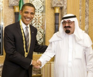 Obama with a gift he received from Saudi Arabia's King Abdullah during a meeting at the king's farm outside Riyadh