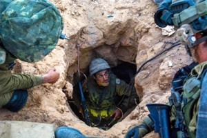 Israeli soldier enters a Hamas tunnel